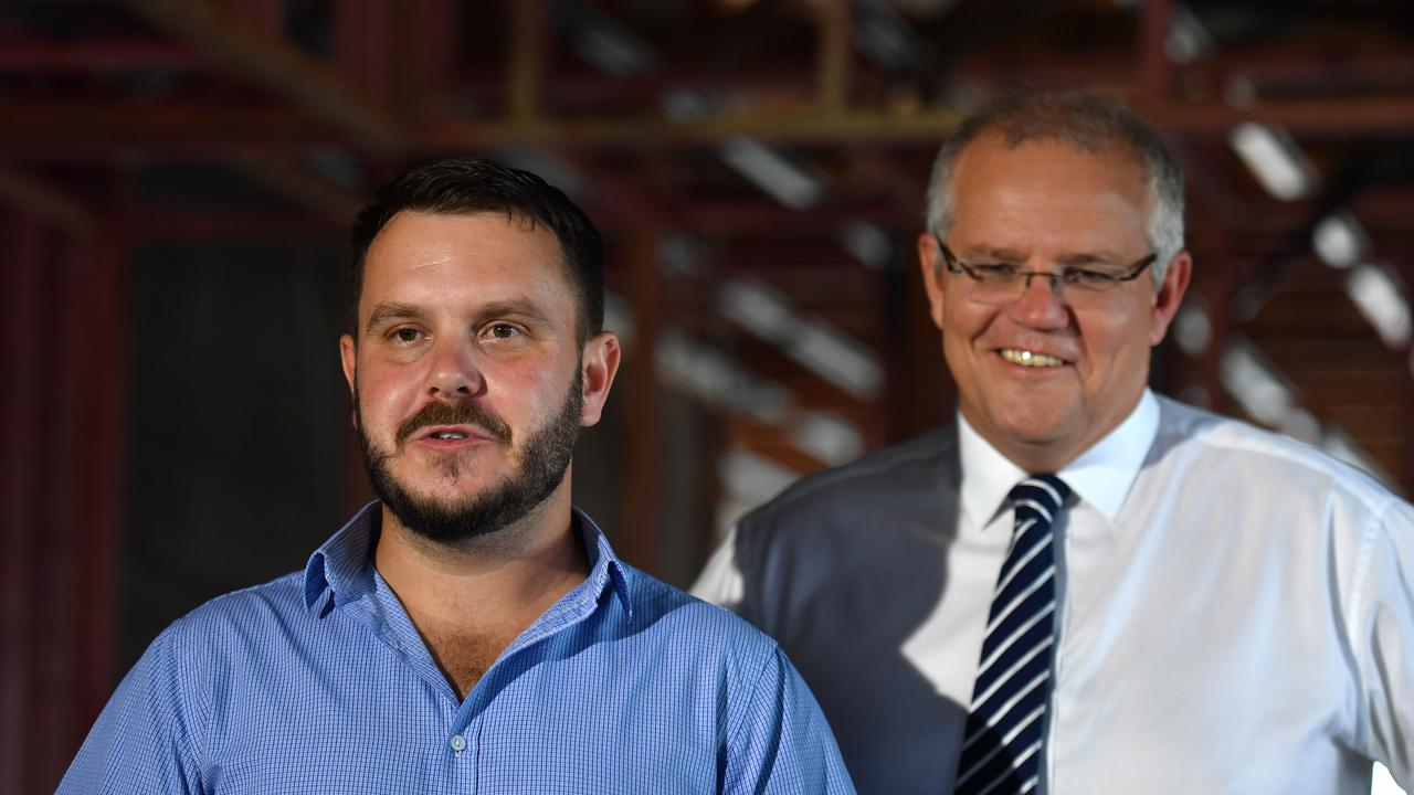 Candidate turned MP for Herbert Phillip Thompson learnt of his mate Bradley Carr's death by suicide moments before he stood next to Prime Minister Scott Morrison at a press conference in Townsville. (AAP Image/Mick Tsikas)