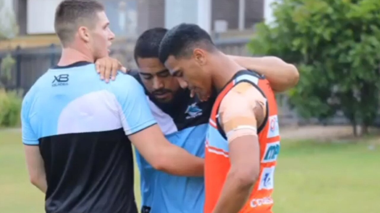 Childhood friends Fine Kula (middle) and Ronaldo Mulitialo at Cronulla training.