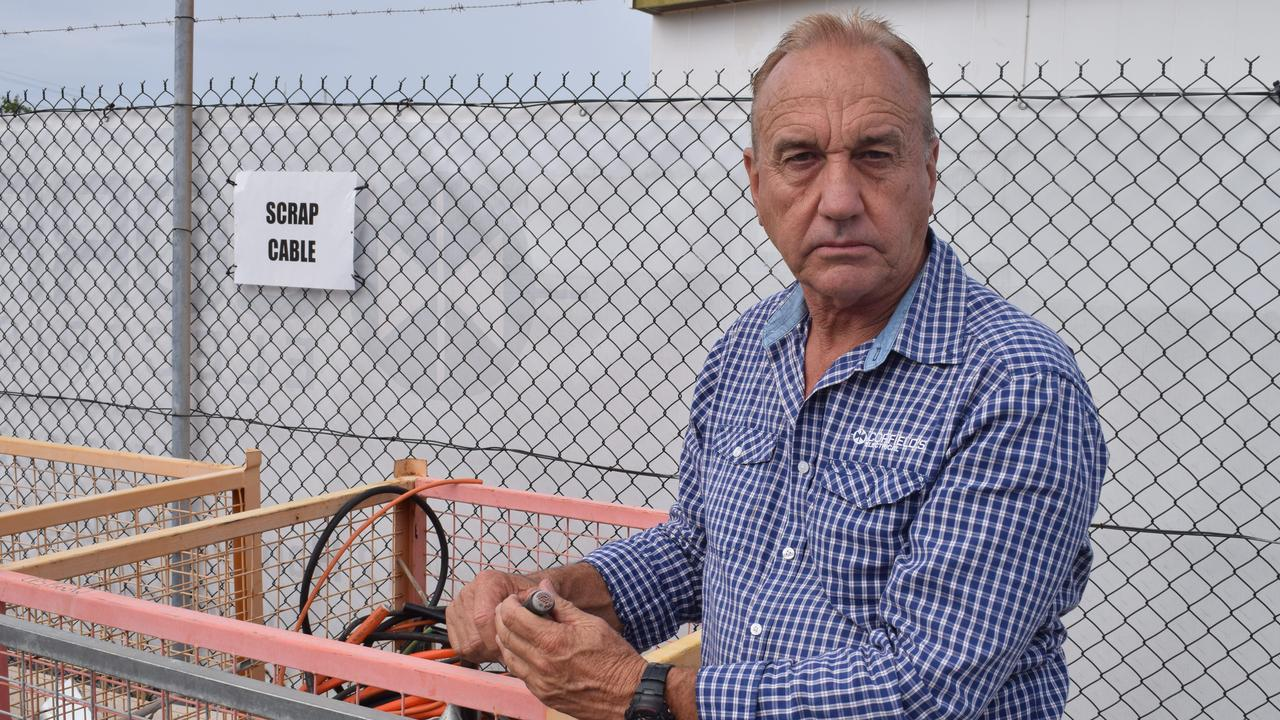 Ken Corfield with copper wire like the kind stolen from Corfield's Electrical