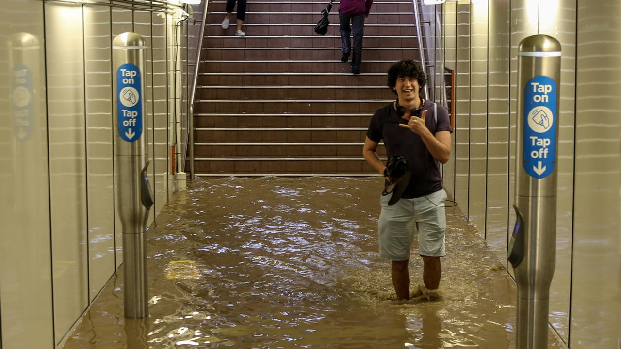 Back on November 28, 2018, commuters struggled against torrential rain and gale force winds across Sydney. Picture: Nicholas Eagar
