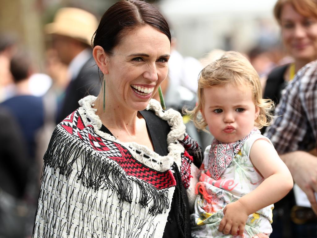 Jacinda Ardern was photographed with her 18-month-old daughter Neve as the pair speed onto the ceremonial grounds of Waitangi. Picture: Fiona Goodall/Getty Images