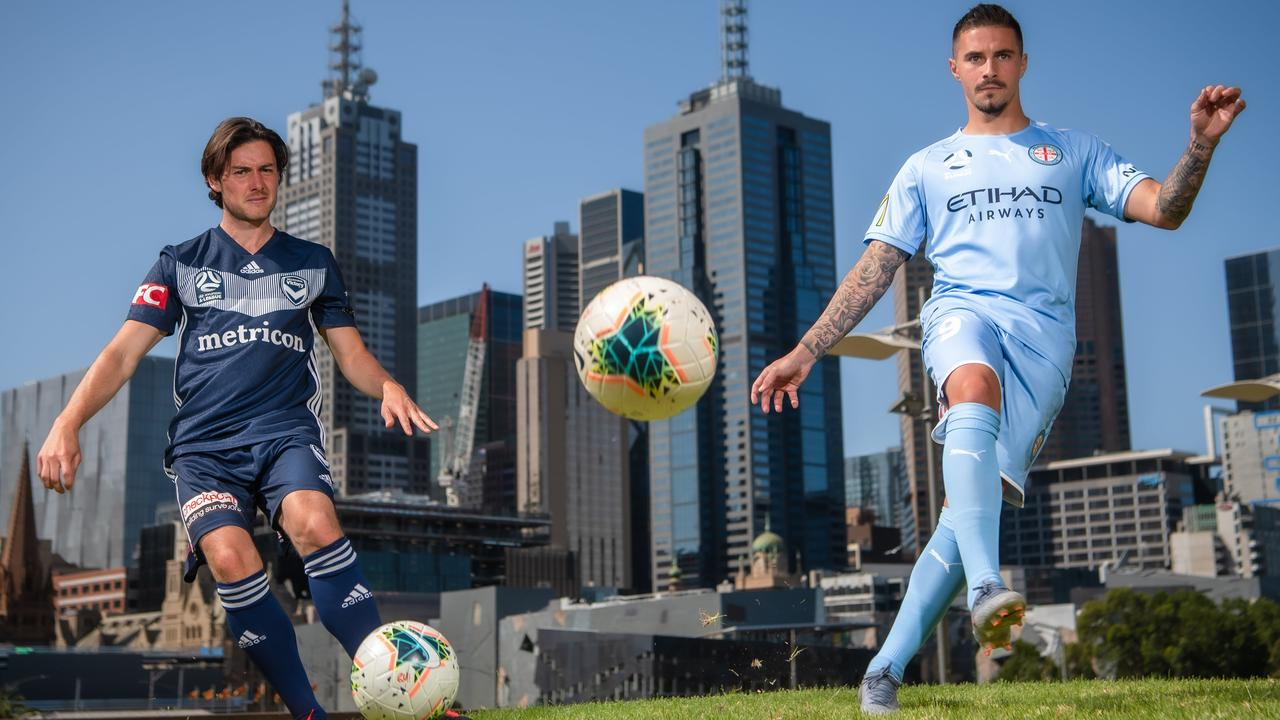Melbourne City's Jamie Maclaren (right) and Melbourne Victory's Marco Rojas get set for Friday night's A-League derby.