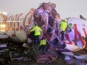 Passenger jet snaps into three