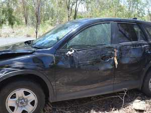 PHOTOS: Car crashed, abandoned between two towns
