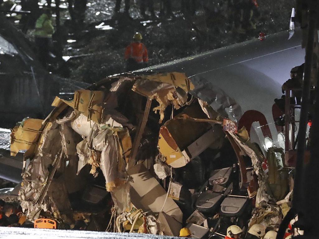Passengers were seen evacuating through cracks in the plane and authorities said many people were injured. (AP Photo)