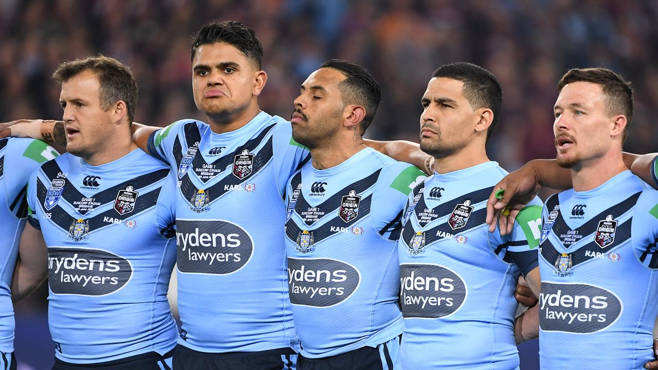 Josh Morris, Latrell Mitchell, Josh Addo-Carr, Cody Walker and Damien Cook are seen during the Australian National Anthem prior to Game 1 of the 2019 State of Origin series. (AAP Image/Dave Hunt)