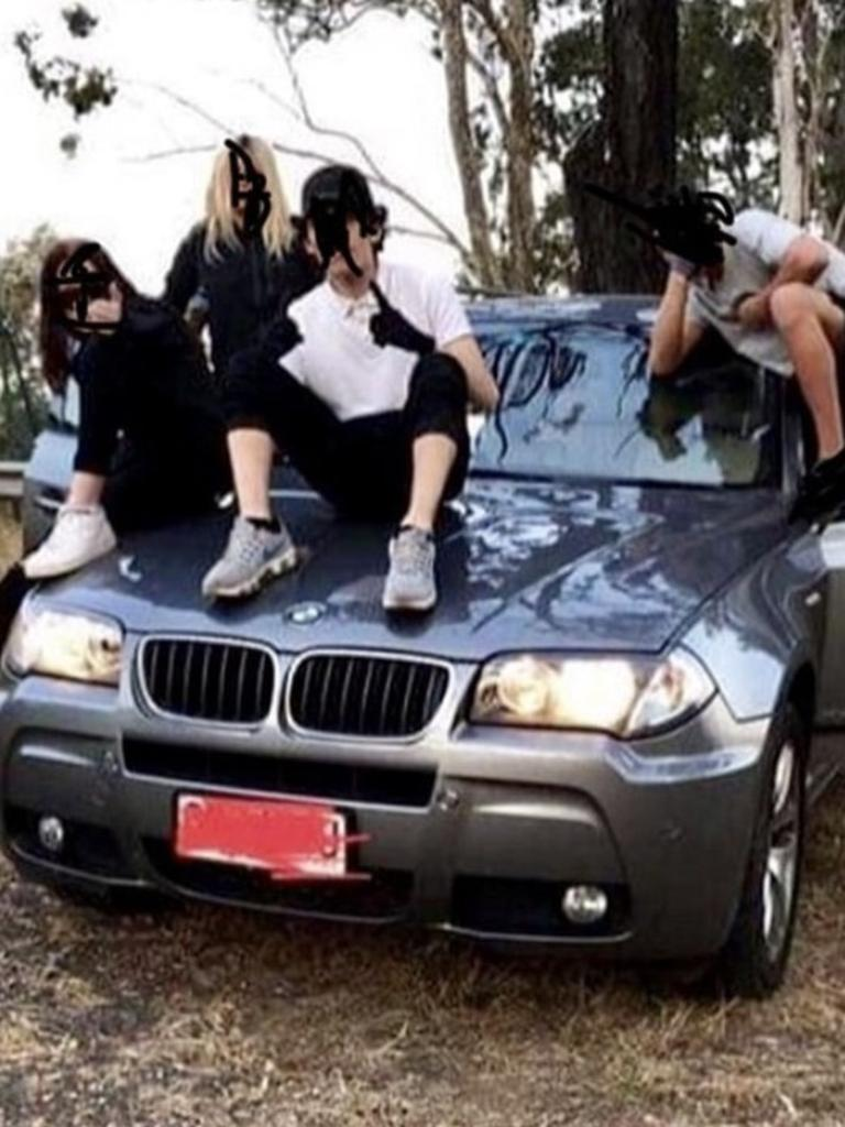 Four members of the Northside Gang on the bonnet of a luxury BMW. Picture: Instagram