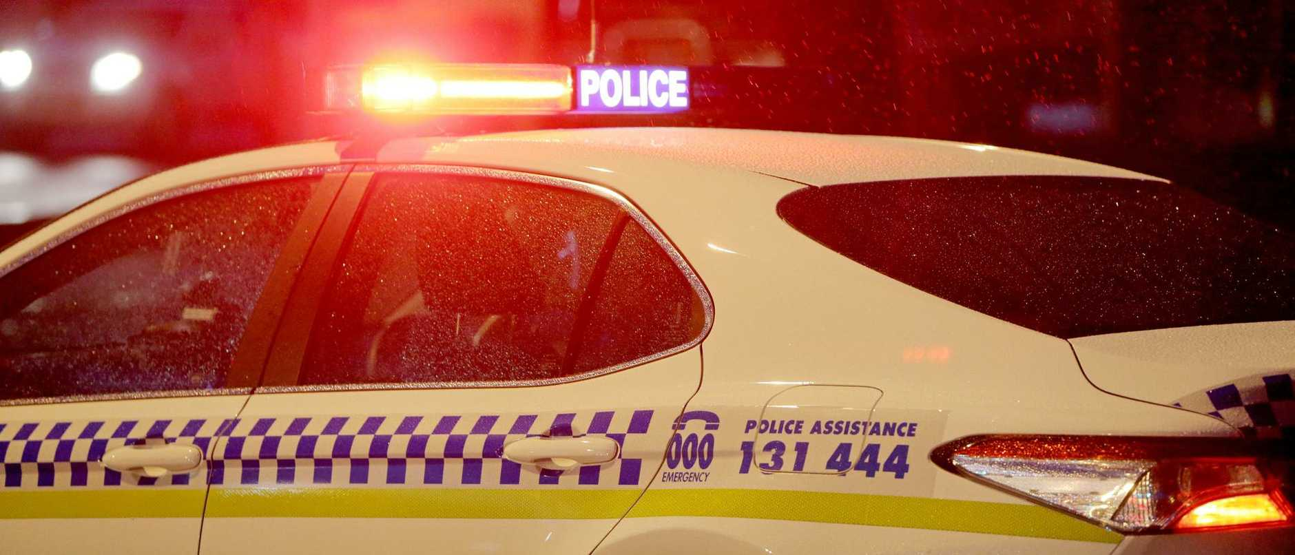 An unidentified man's body has been found in the middle of a road in NSW.