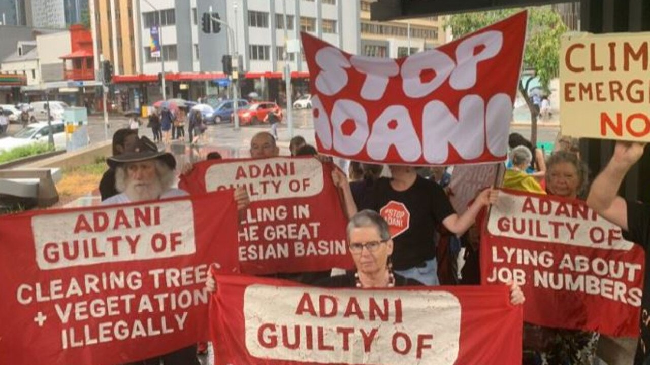 Protesters outside Brisbane Magistrates Court where Adani is appearing on a land clearing charge. Picture: 10 News