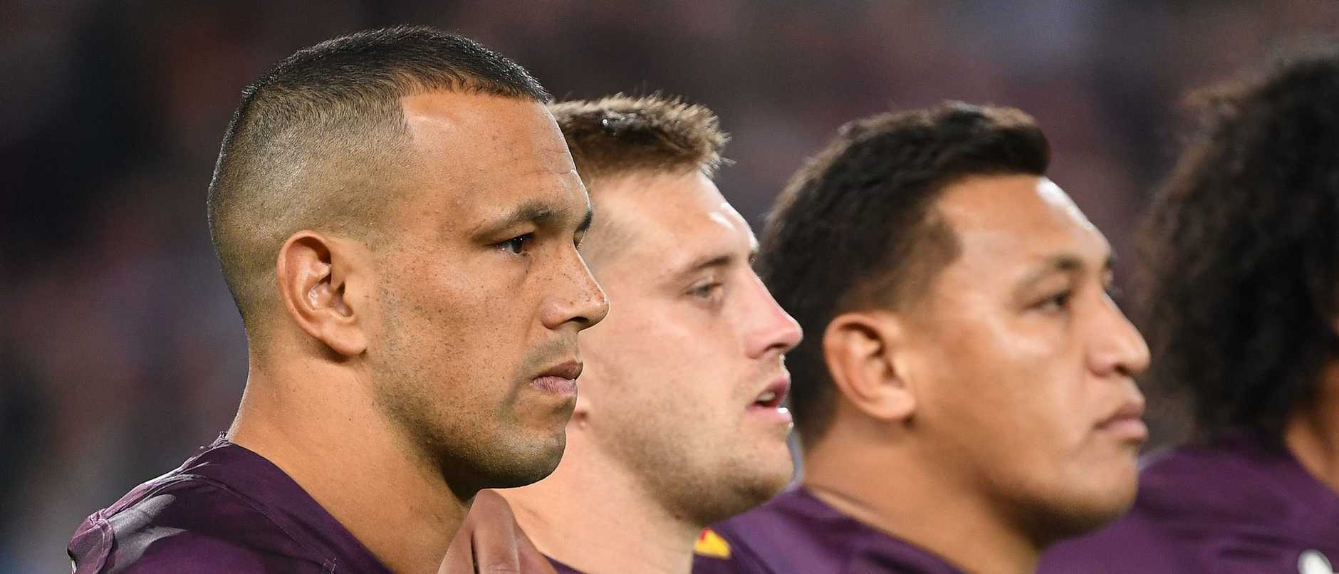 The Maroons' Will Chambers, Cameron Munster and Josh Papalii link arms during a rendition of the national anthem last year. Picture: Dave Hunt/AAP
