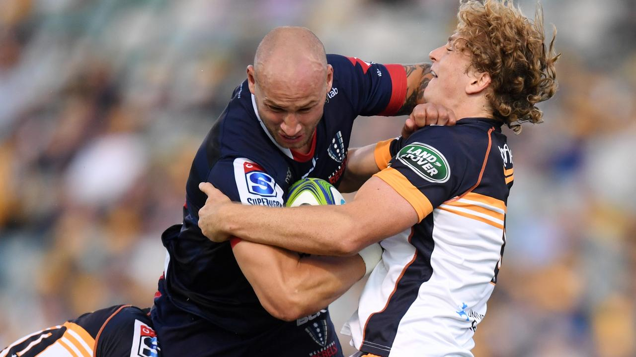 Billy Meakes is wrapped up by the Brumbies' Joe Powell. Picture: AAP