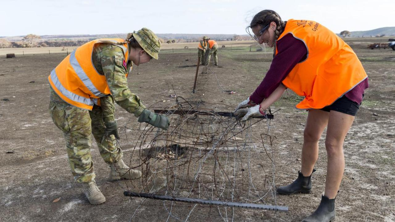 Australian Army Gunner Emily Robertson, from the 9th Regiment, Royal Australian Artillery and BlazeAid volunteer Claire Serraglio clearing damaged fencing on Kangaroo Island. Picture: Contributed.