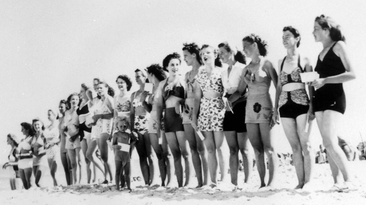 Displaying an array of bathing fashion during judging in the Surf Girl Competition, Kings Beach, Caloundra, 1947.