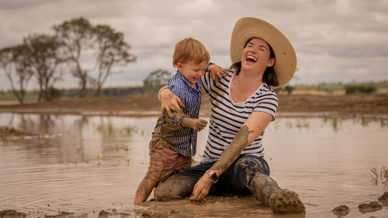 Shannon Crocker with son Angus (3) playing in the mud at their Muckadilla property after a week of rain. Photo - Katarina Silvester