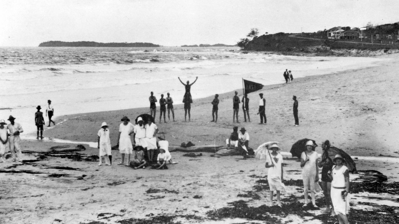 Alexandra Headland Surf Life Saving Club members and day trippers on Alexandra Headland Beach, late 1920s.