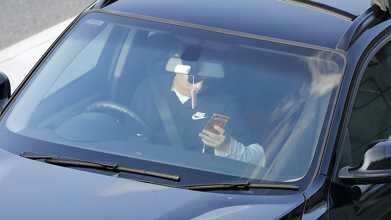 Many drivers are obsessed with their phones.