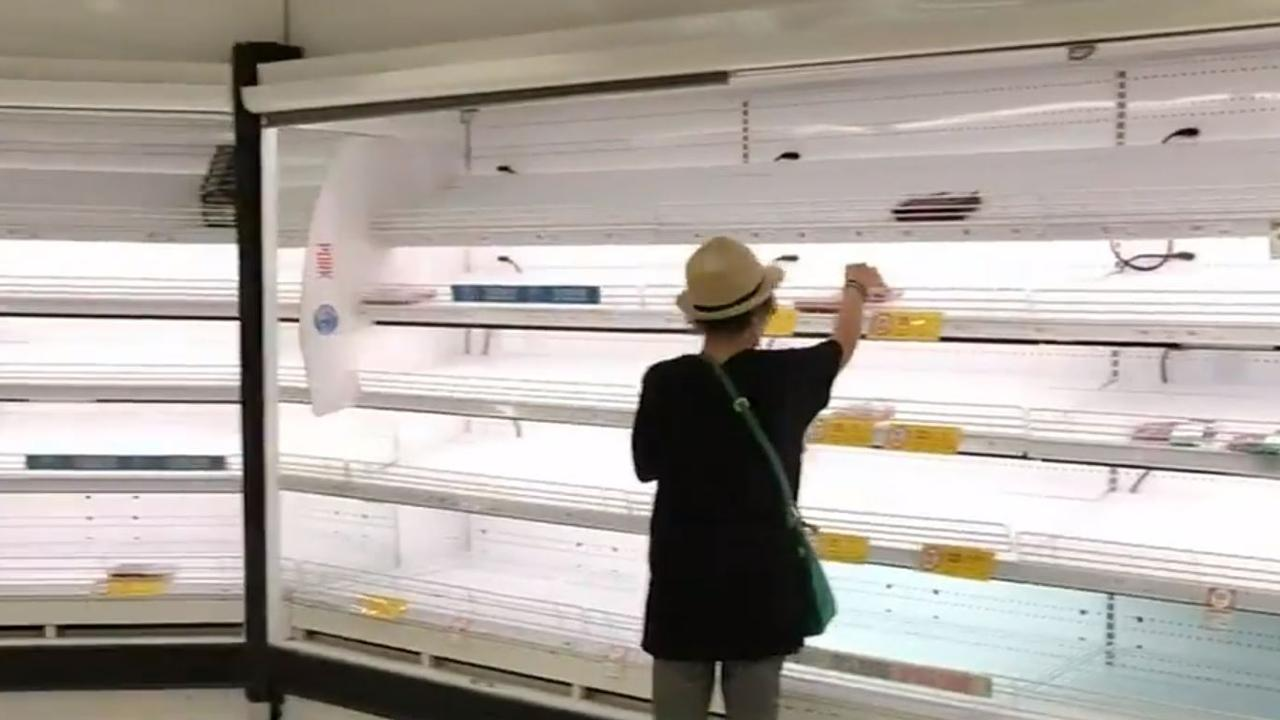 Empty shelves at Coles and Woolworths stores in Karratha ahead of Cyclone Damien making landfall. Picture: Channel 9