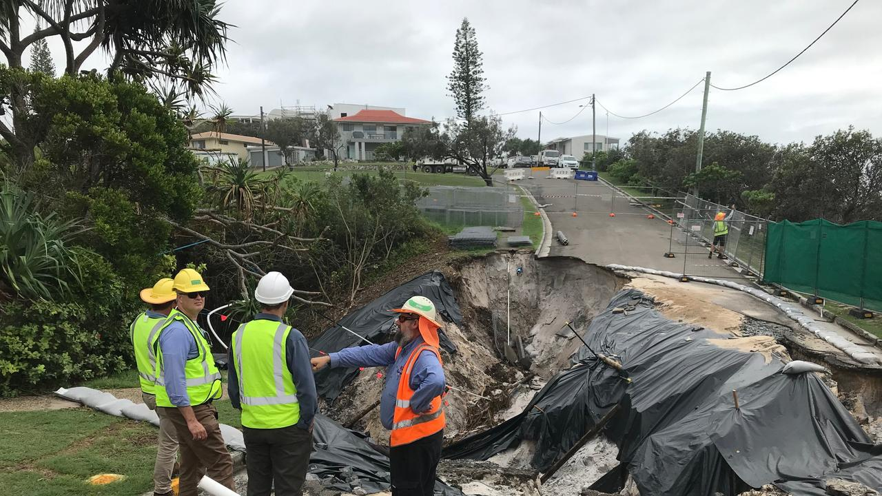 Noosa Council and Unitywater engineers inspect the damage this morning after Tingira Crescent, Sunrise Beach collapsed for a second time causing extensive damage