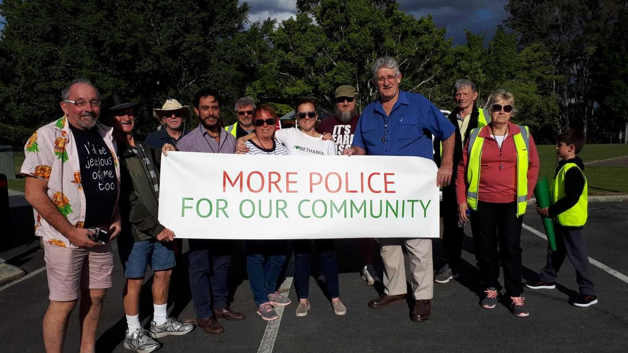 Bethania residents at a street march in June to lobby for more police. The march was past the public housing property in Federation Dr.