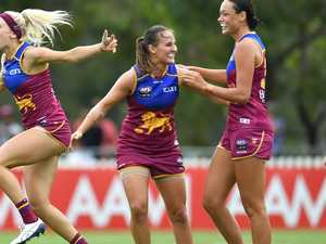 Crows stunned by roaring Lions in AFLW opener