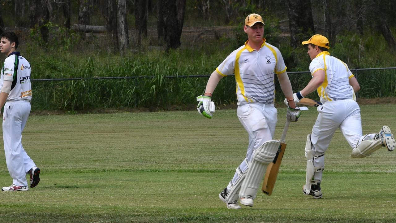 THERE IT IS: The Glen's centurion David Heymer and Zane Robertson go for final runs against Rockhampton Brothers at Sun Valley Oval. PICTURE: Samantha Reynolds