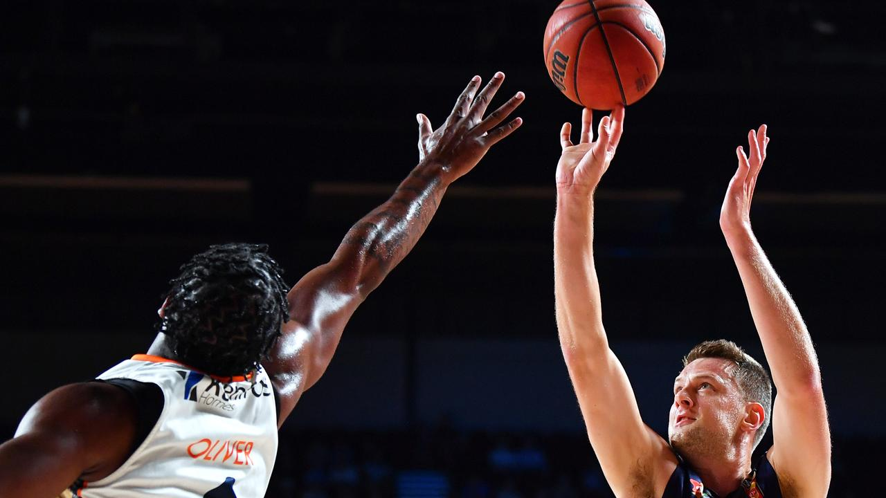 ADELAIDE, AUSTRALIA – FEBRUARY 08: Daniel Johnson of the 36ers shoots over Cameron Oliver of the Taipans during the match between the Adelaide 36ers and the Cairns Taipans at the Adelaide Entertainment Centre on February 08, 2020 in Adelaide, Australia. (Photo by Mark Brake/Getty Images)
