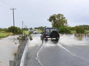 Flooded road causes people to turn back