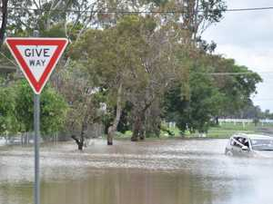 Car trapped in flood waters, crews on scene
