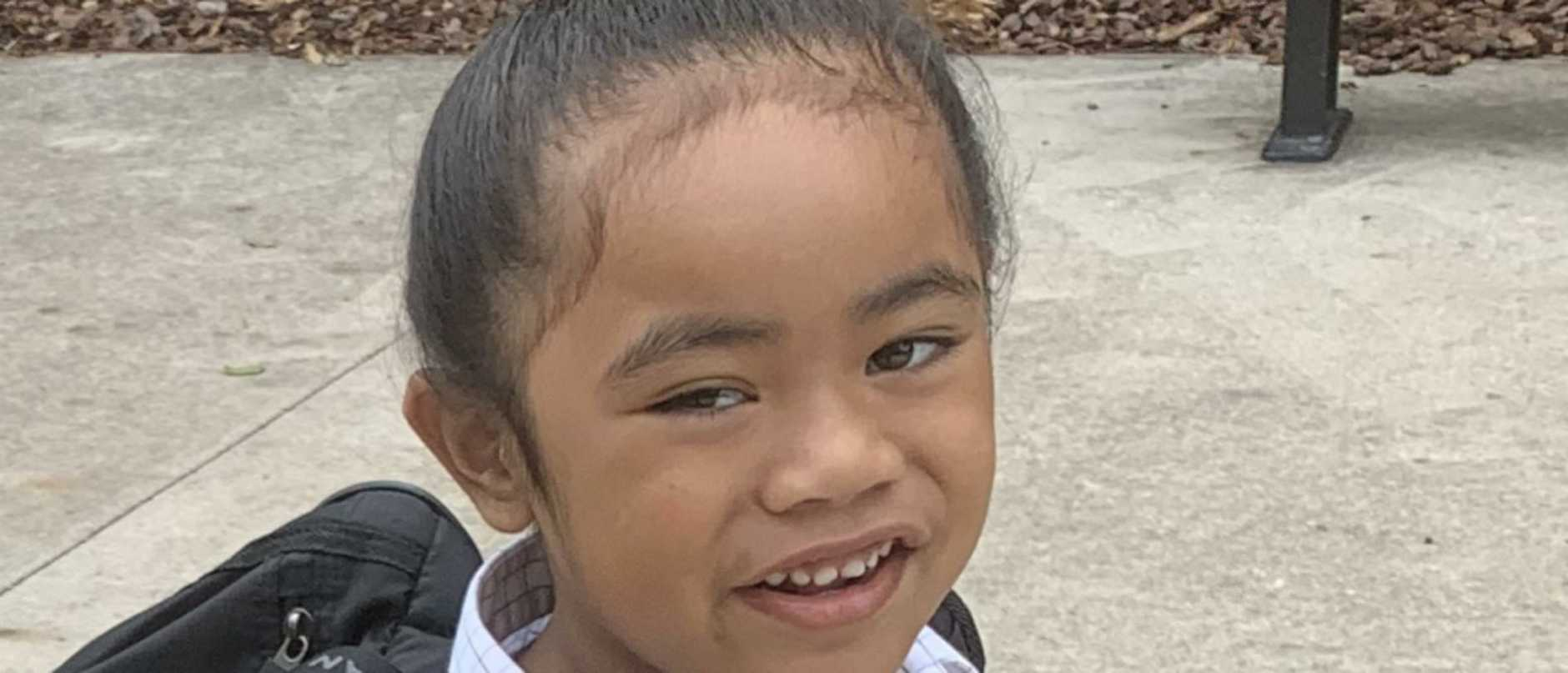 Australian Christian College Moreton has told five-year-old Cyrus Taniela he will need to cut his bun to meet school dress policies but his traditional hair-cutting ceremony is not for a year.