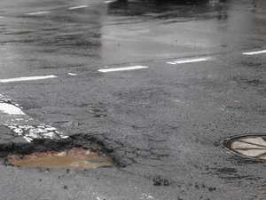 SLOW DOWN: Large potholes on our roads after heavy rain
