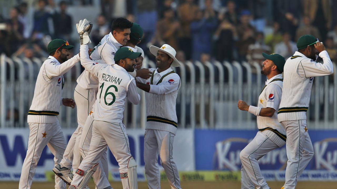 Pakistan pacer Naseem Shah, center without cap, celebrates with teammates after taking the wicket of Bangladesh batsman Mahmudullah during the third day of their 1st test cricket match at Rawalpindi cricket stadium in Rawalpindi, Pakistan, Sunday, Feb. 9, 2020. (AP Photo/Anjum Naveed)