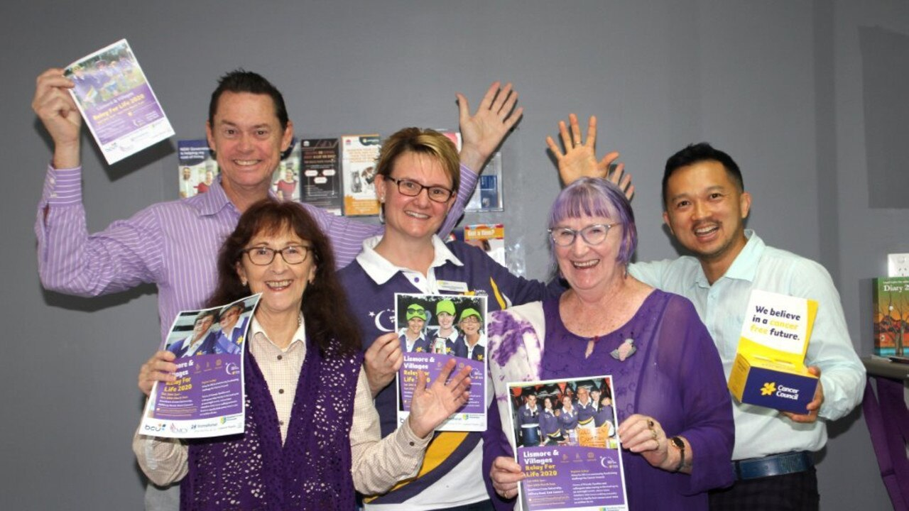 GET PURPLE: From left: John Dawson, Janelle Saffin MP, Leanne Thompson, Carmel Cook and Ronny Susanto. Photo: Marie Cook