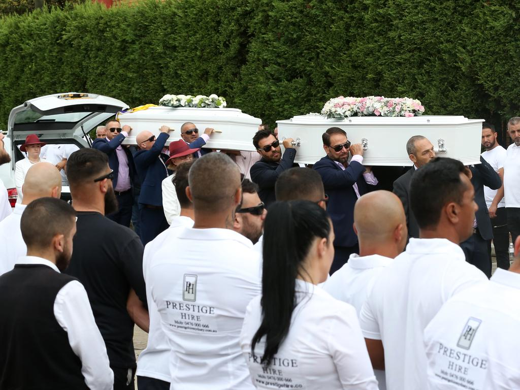 The coffins of Anthony, 13, Angelina, 12 and eight-year-old Sienna Abdallah are seen arriving for their funeral at Our Lady of Lebanon Co-Cathedral. Picture: Danny Casey/AAP