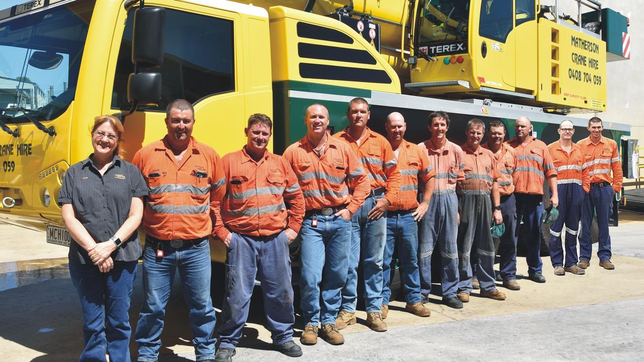 Staff of Matherson Crane Hire celebrate the company's 40th anniversary