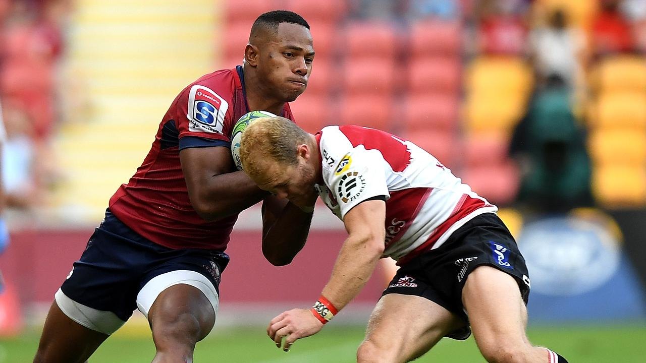 Filipo Daugunu takes on the defence of Dillon Smit of the Lions. Picture: Bradley Kanaris/Getty Images