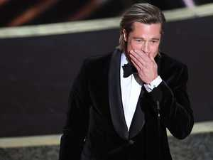 Brad Pitt claims first acting Oscar