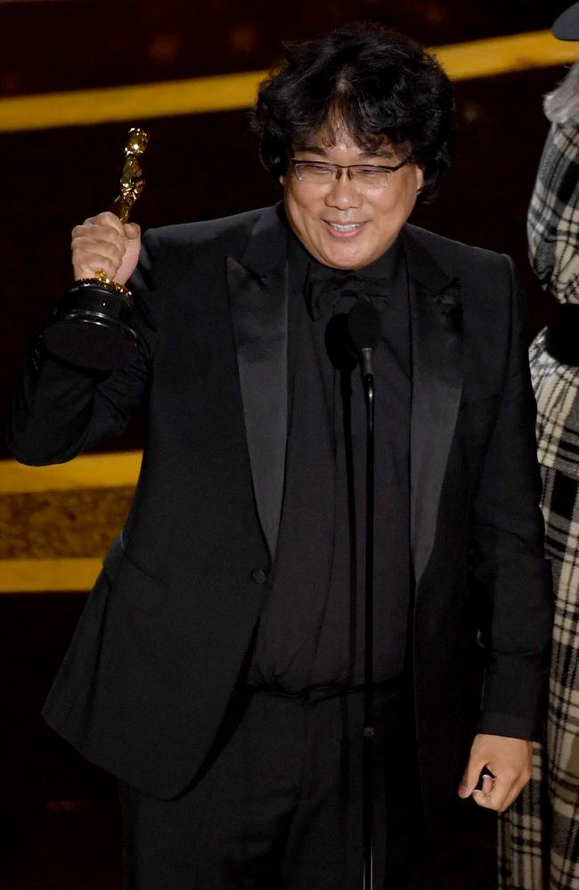 Bong Joon-ho accepts the Best Original Screenplay for Parasite. Picture: Getty Images