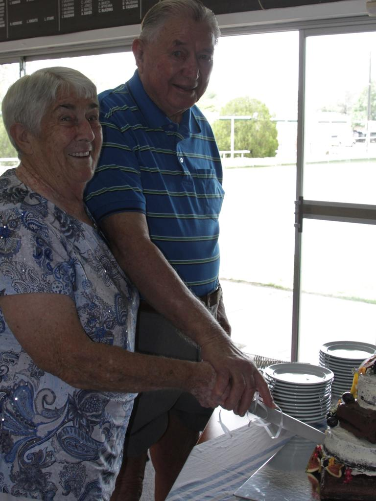 Melda and George cut their anniversary cake.