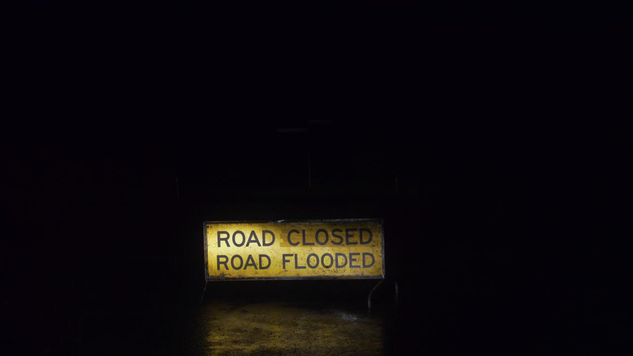 Two motorists were trapped in floodwater at Yalangur last night.
