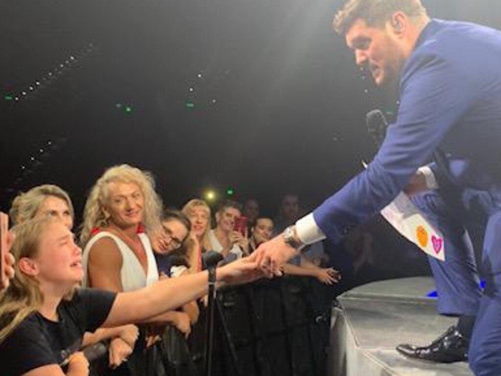 Michael Buble with fan Abby Fellows in Brisbane.