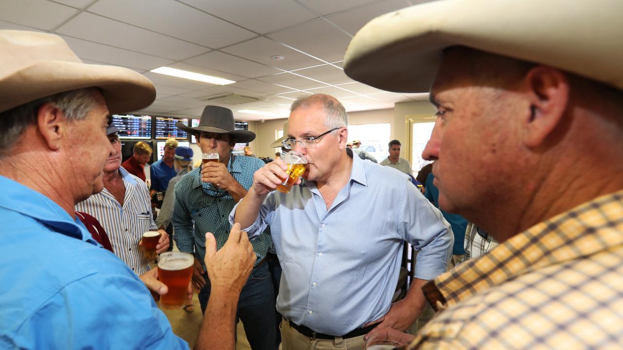 Prime Minister Scott Morrison listens to locals in Julia Creek. Picture: Nigel Hallett/News Corp
