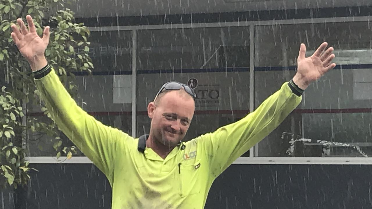Aaron Noonan was working in Mary Street yesterday afternoon when it bucketed down, delivering much needed rain to the Gympie region. Photo: Philippe Coquerand