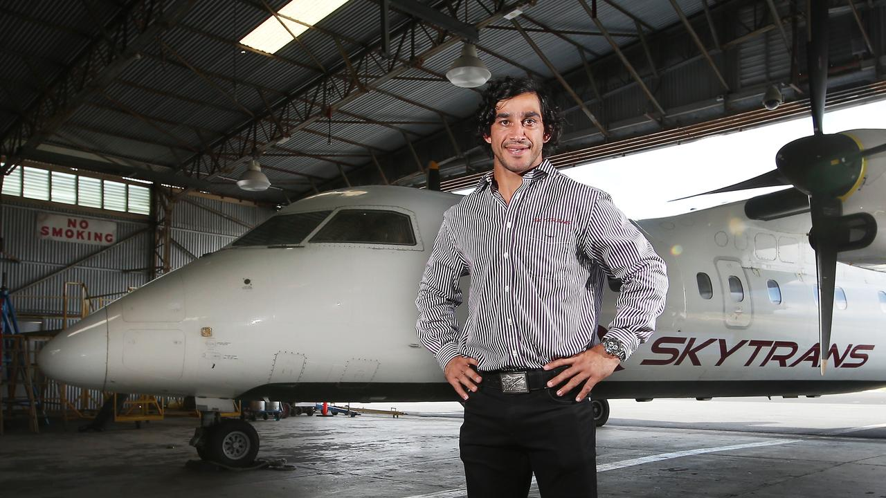 Cairns airline Skytrans co-owner, NRL player Jonathan Thurston with the company's Dash 8 plane. Picture: Brendan Radke.