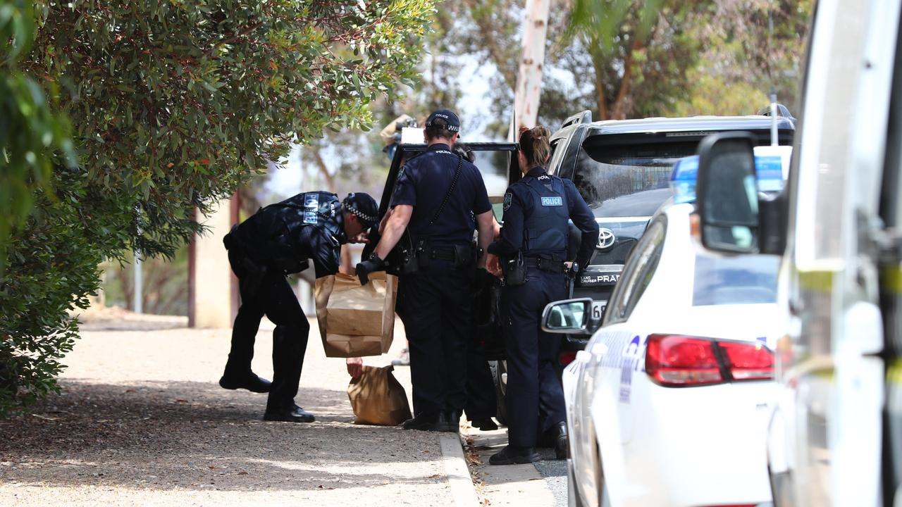 Police bring out evidence bags from the deceased man's house. Picture: Tait Schmaal