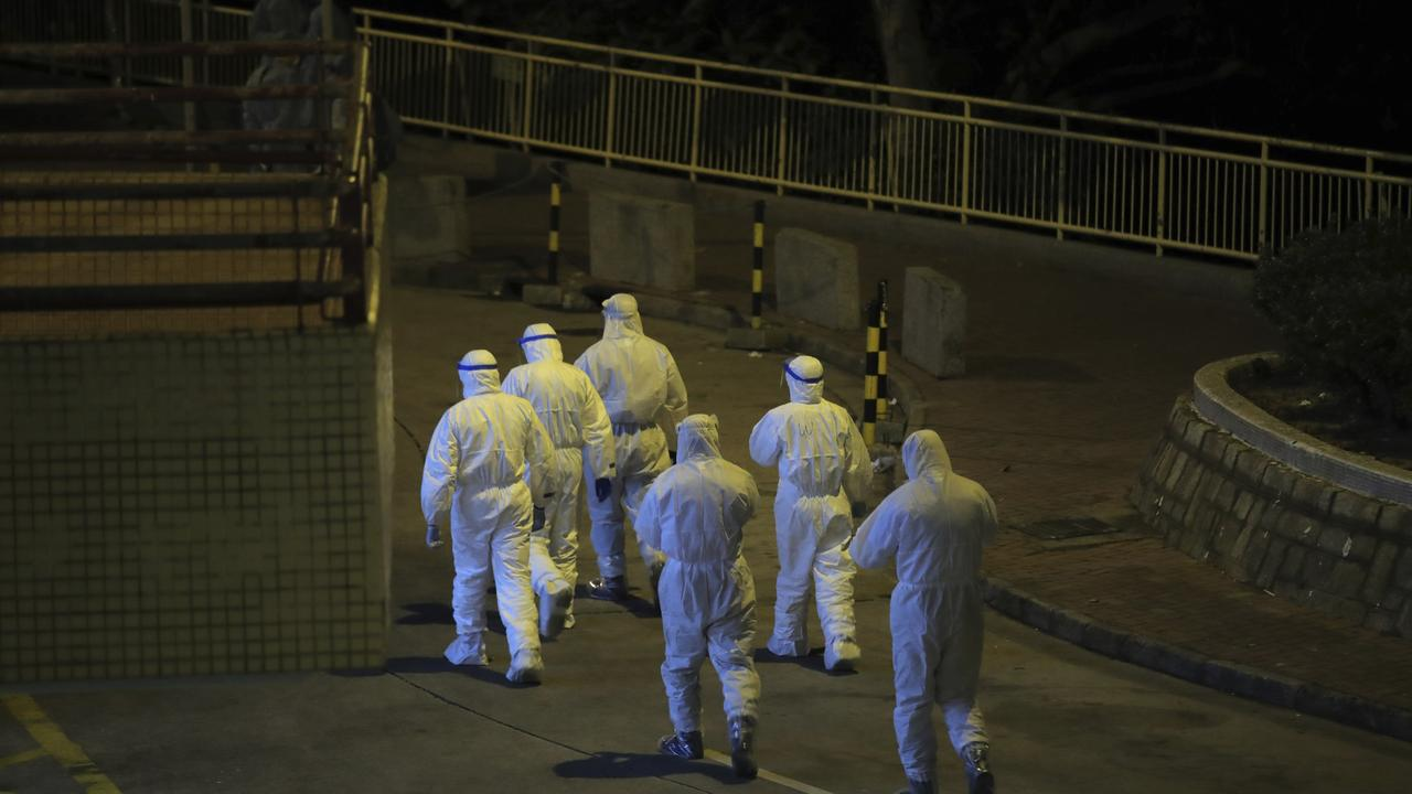There are fears the virus may be able to spread through pipes. Picture: AP/Kin Cheung