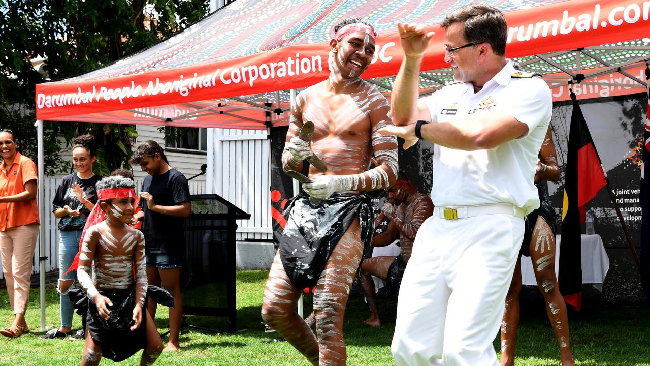Darumbal dancers with Commodore Jonathan Earley, ASMTI manager, at the Land Handover ceremony and Darumbal Office opening