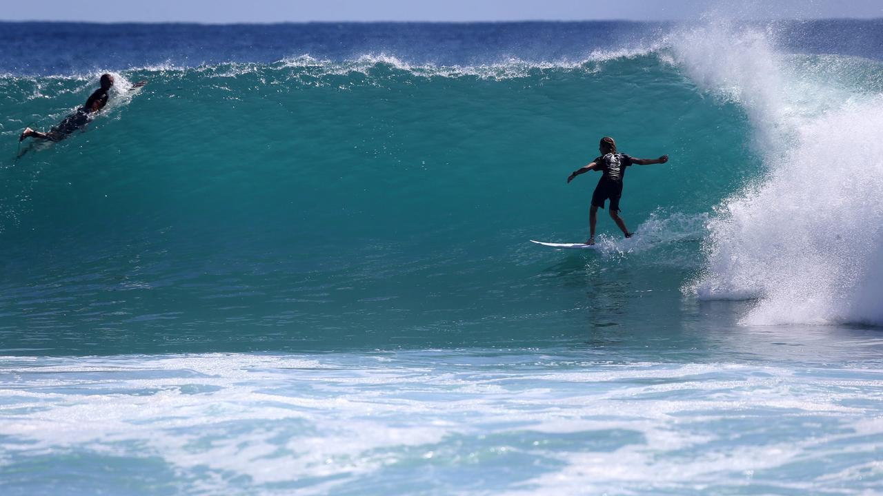 Surfers enjoy a rising swell at Burleigh Heads. Picture: Mike Batterham