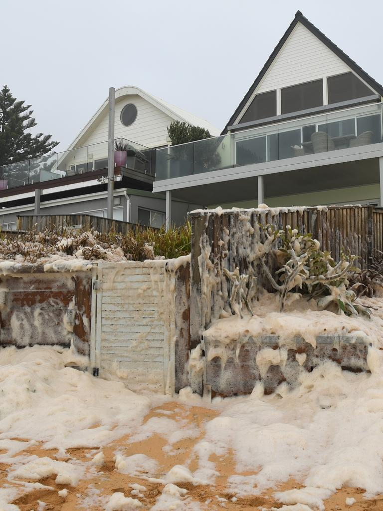 Sea foam brought by waves approaches on beach front houses after heavy rain and storms at Collaroy in Sydney's Northern Beaches. AAP Image/Joel Carrett