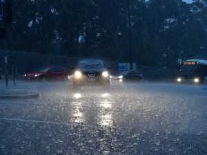 TAKE COVER: Torrential downpour as storm warning issued