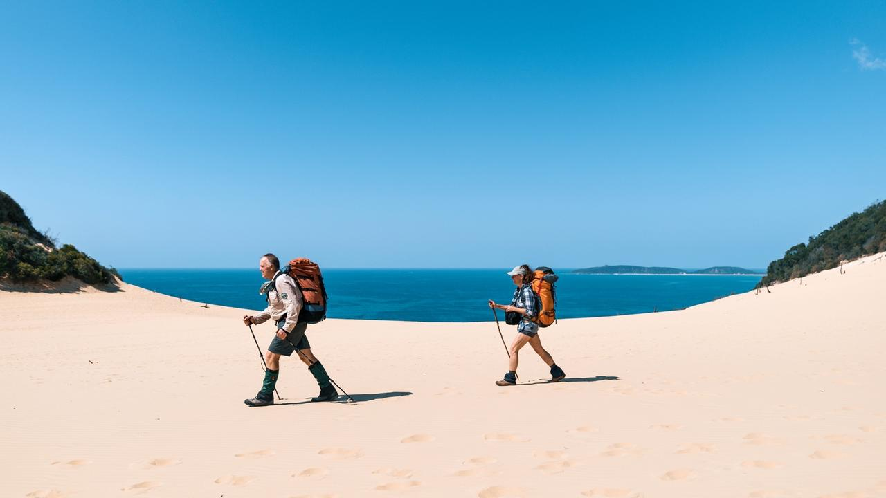 Tackling the Carlo Sandblow on the Cooloola Great Walk. Picture: Reuben Nutt